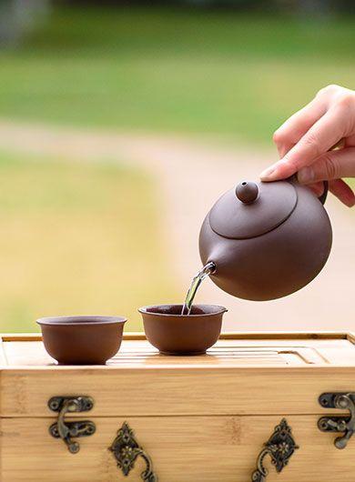 Service à thé de voyage en Zi Sha Xishi avec un coffret en bamboo
